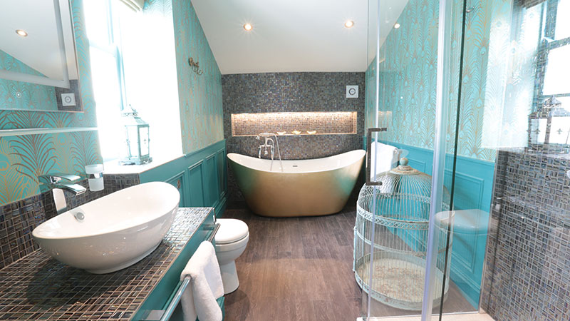Peacock coloured mosaic tiled bathroom