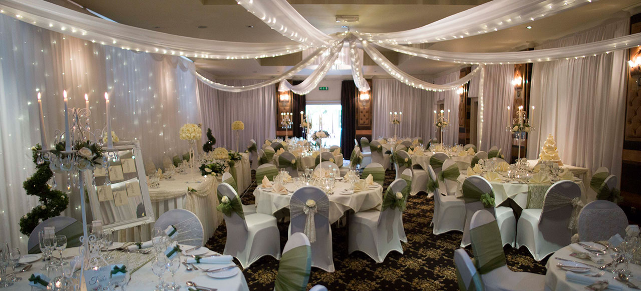 crown wedding packages - chair covers, ivory table linen and candle centre pieces